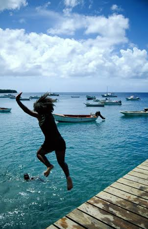 Girl jumping off a pier, Westpunt, Curacao