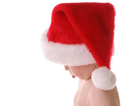 kind met kerstman muts kerstmis